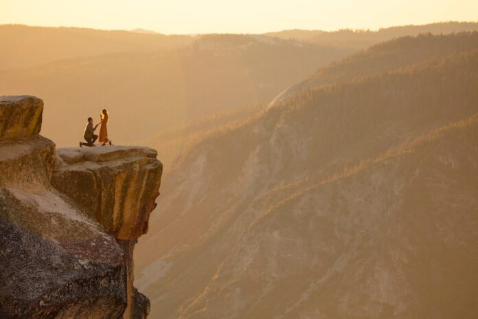 Couple, proposing on cliff side