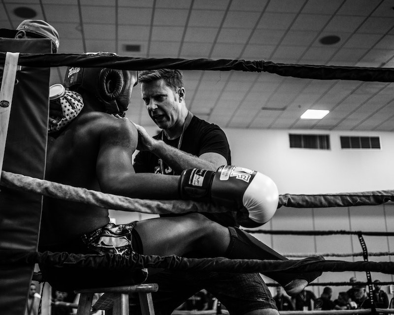 Boxing fighter in ring with coach